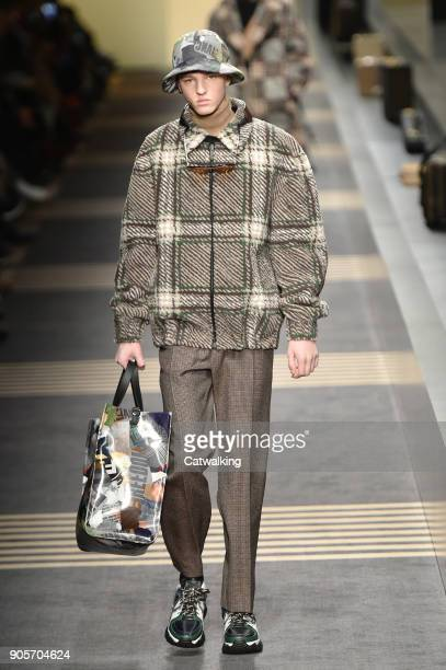 A model walks the runway at the Fendi Autumn Winter 2018 fashion show during Milan Menswear Fashion Week on January 15 2018 in Milan Italy