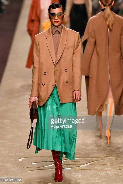 A model walks the runway at the Fendi Ready to Wear Fall/Winter 20192020 fashion show at Milan Fashion Week Autumn/Winter 2019/20 on February 21 2019...