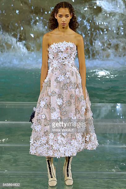A model walks the runway at the Fendi Roma 90 Years Anniversary fashion show at the Fontana di Trevi on July 7 2016 in Rome Italy