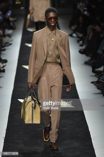 A model walks the runway at the Fendi show during Milan Menswear Fashion Week Autumn/Winter 2019/20 on January 14 2019 in Milan Italy