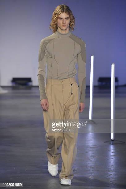 A model walks the runway at the Feng Chen Wang Fall/Winter 20202021 fashion show during London Fashion Week Men's January 2020 on January 06 2020 in...