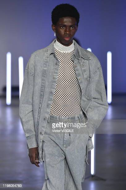 Model walks the runway at the Feng Chen Wang Fall/Winter 2020-2021 fashion show during London Fashion Week Men's January 2020 on January 06, 2020 in...