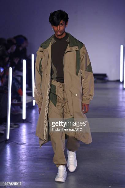 Model walks the runway at the Feng Chen Wang show during London Fashion Week Men's January 2020 on January 06, 2020 in London, England.