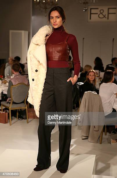A model walks the runway at The FF AW15 show at The Savoy Hotel on April 21 2015 in London England