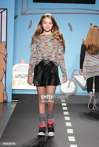 A model walks the runway at the Flowers by ZOE By Kourageous Kids preview during JCPenney showcase at petiteParade Kids Fashion Week in Collaboration...