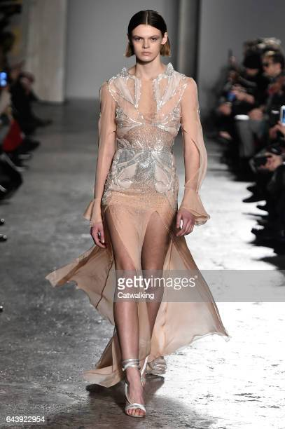 A model walks the runway at the Francesco Scognamiglio Autumn Winter 2017 fashion show during Milan Fashion Week on February 22 2017 in Milan Italy