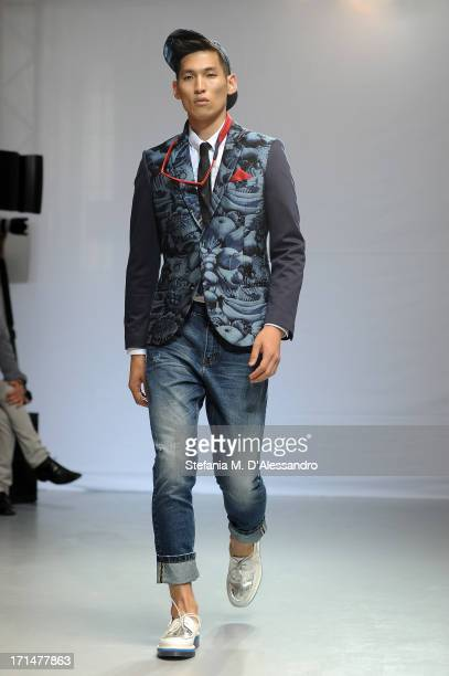 A model walks the runway at the Frankie Morello show during Milan Menswear Fashion Week Spring Summer 2014 on June 25 2013 in Milan Italy