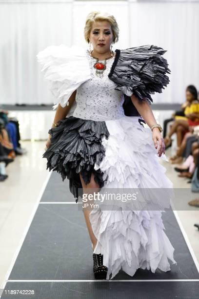 A model walks the runway at the FTM Fashion Week S7 at Sturgeon City on November 23 2019 in Jacksonville North Carolina