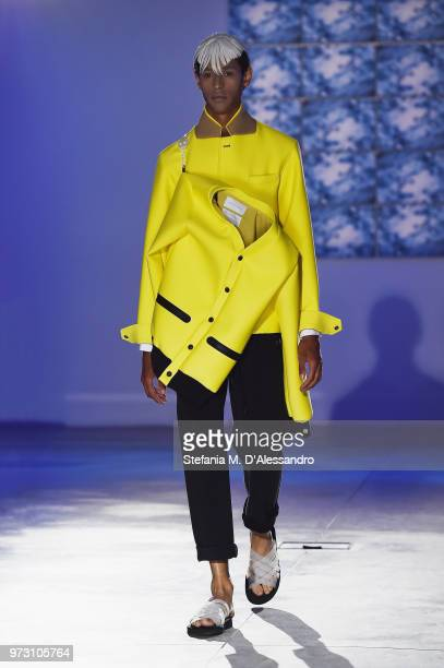 A model walks the runway at the Fumito Ganryu fashion show during the 94th Pitti Immagine Uomo on June 13 2018 in Florence Italy