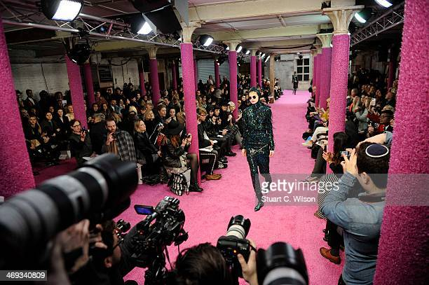 A model walks the runway at the Fyodor Golan show at London Fashion Week AW14 at The Farmiloe Building on February 14 2014 in London England