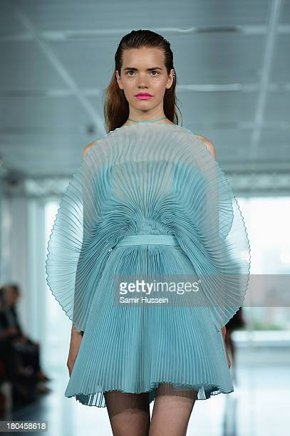 A model walks the runway at the Fyodor Golan show during London Fashion Week SS14 at 280 High Holborn on September 13 2013 in London England