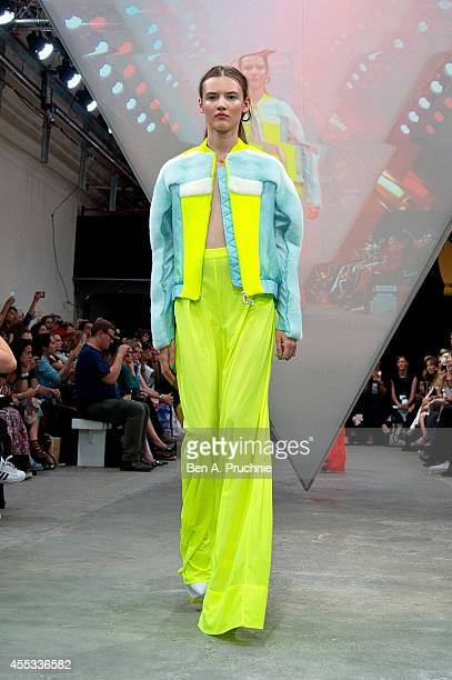 A model walks the runway at the Fyodor Golan show during London Fashion Week Spring Summer 2015 on September 12 2014 in London England