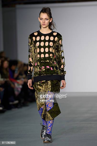 A model walks the runway at the Fyodor Golan show during London Fashion Week Autumn/Winter 2016/17 at Brewer Street Car Park on February 19 2016 in...