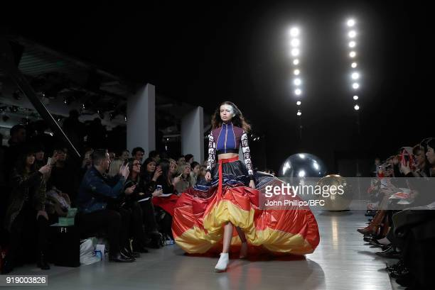 A model walks the runway at the FYODOR GOLAN show during London Fashion Week February 2018 at BFC Show Space on February 16 2018 in London England