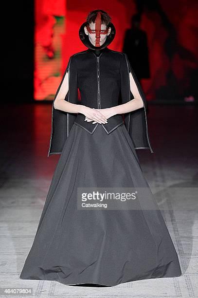 Model walks the runway at the Gareth Pugh Autumn Winter 2015 fashion show during London Fashion Week on February 21, 2015 in London, United Kingdom.