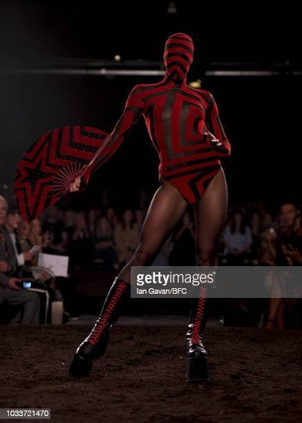 Model walks the runway at the Gareth Pugh show during London Fashion Week September 2018 at The Old Selfridges Hotel on September 15, 2018 in London,...