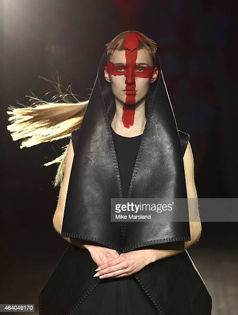Model walks the runway at the Gareth Pugh show during London Fashion Week Fall/Winter 2015/16 at Victoria & Albert Museum on February 21, 2015 in...