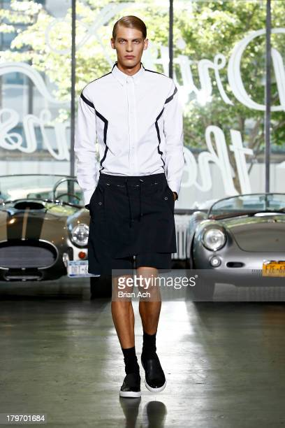 A model walks the runway at the General Idea fashion show during MercedesBenz Fashion Week Spring 2014 at the Classic Car Club on September 6 2013 in...