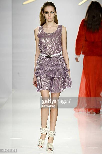 A model walks the runway at the Genny Autumn Winter 2014 fashion show during Milan Fashion Week on February 21 2014 in Milan Italy