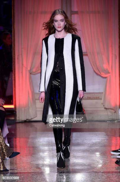 A model walks the runway at the Genny Autumn Winter 2018 fashion show during Milan Fashion Week on February 22 2018 in Milan Italy