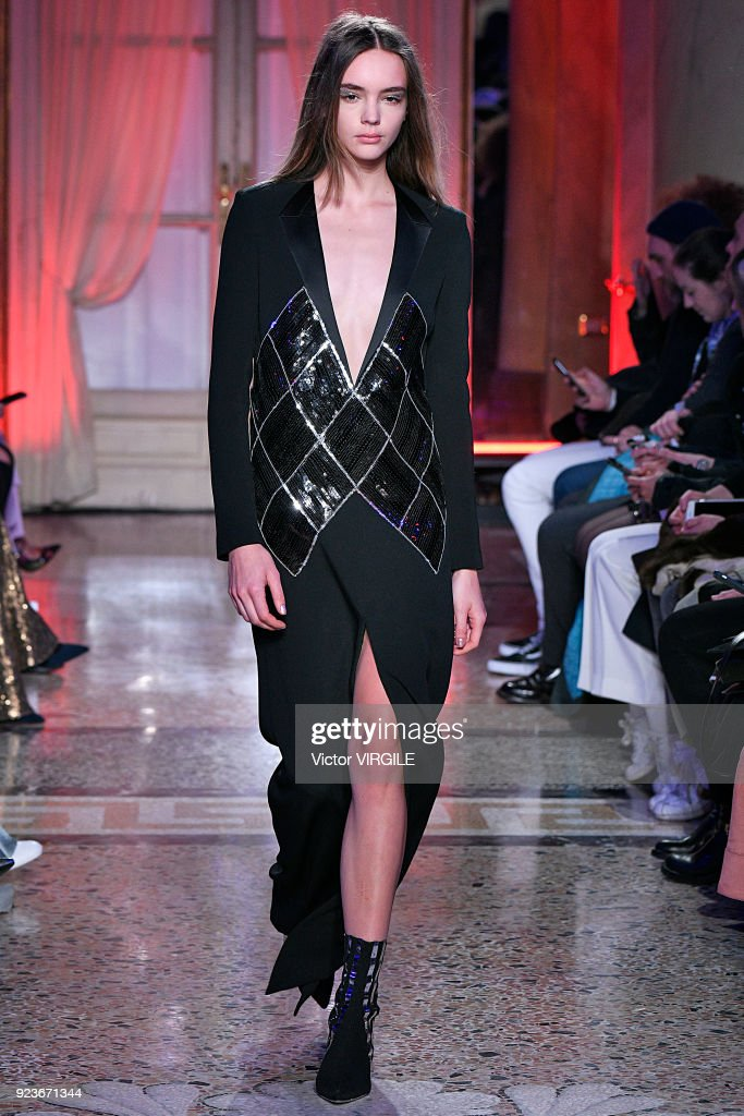 A model walks the runway at the Genny Ready to Wear Fall/Winter 2018-2019 fashion show during Milan Fashion Week Fall/Winter 2018/19 on February 22, 2018 in Milan, Italy.