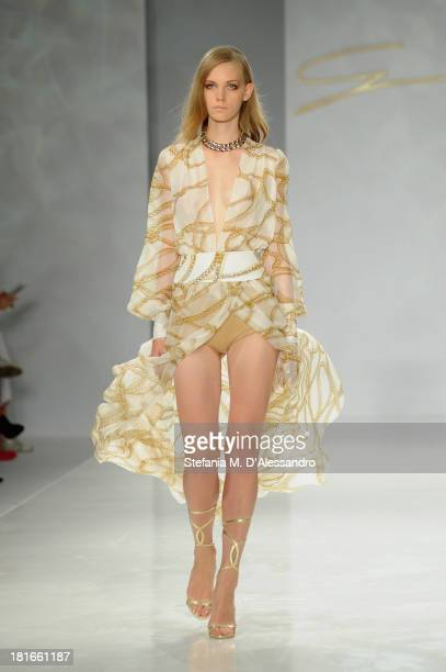 A model walks the runway at the Genny show as a part of Milan Fashion Week Womenswear Spring/Summer 2014 at on September 23 2013 in Milan Italy