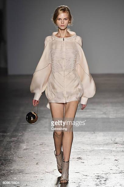 A model walks the runway at the Genny Spring Summer 2017 fashion show during Milan Fashion Week on September 22 2016 in Milan Italy