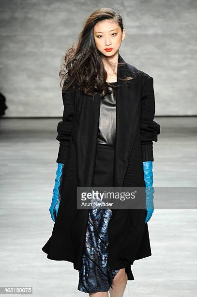 A model walks the runway at the Georgine fashion show during MercedesBenz Fashion Week Fall 2014 at The Pavilion at Lincoln Center on February 9 2014...