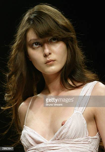 A model walks the runway at the Ghost fashion show during London Fashion Week A/W 04/05 at The BFC Tent on February 18 2004 in London