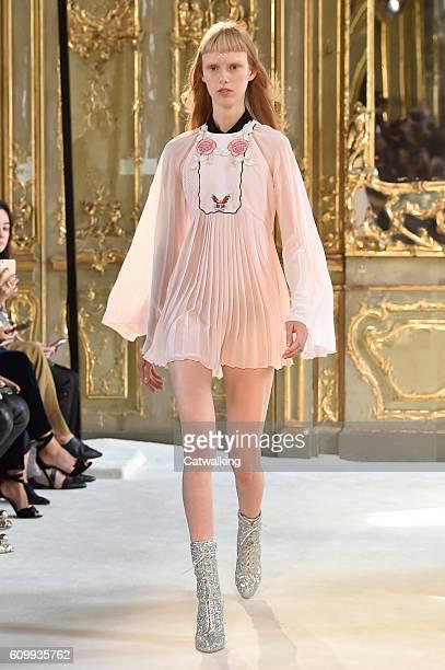 A model walks the runway at the Giamba Spring Summer 2017 fashion show during Milan Fashion Week on September 23 2016 in Milan Italy