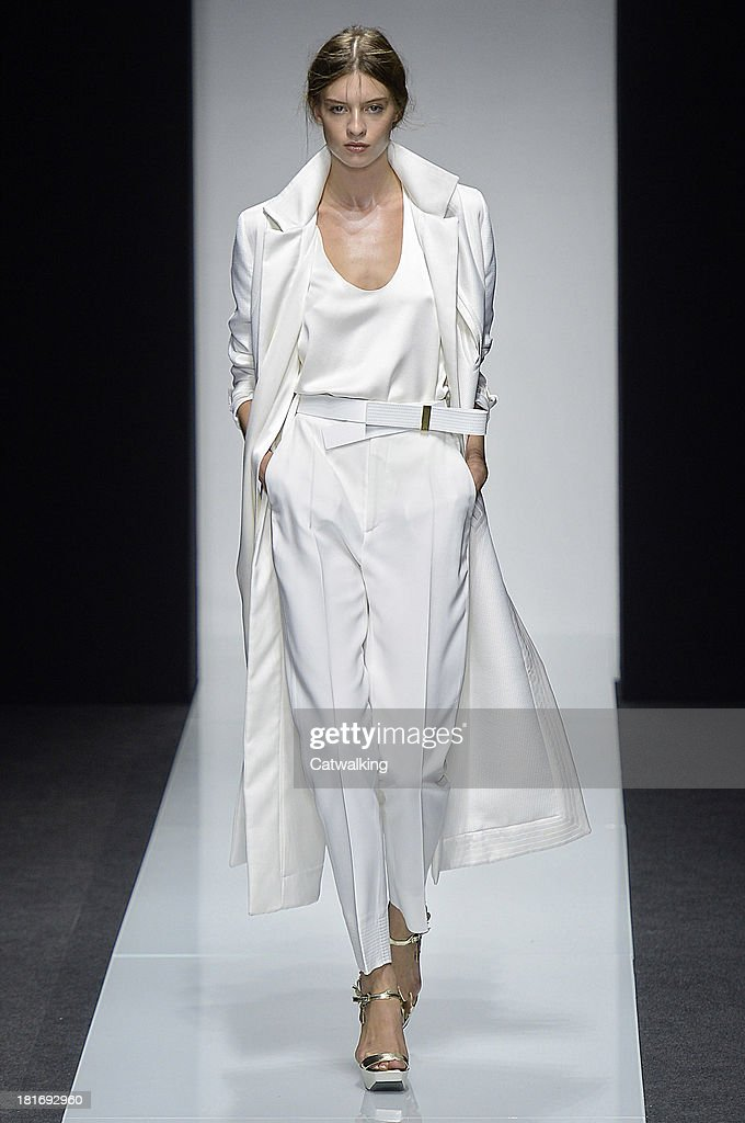A model walks the runway at the Gianfranco Ferre Spring Summer 2014 fashion show during Milan Fashion Week on September 23, 2013 in Milan, Italy.
