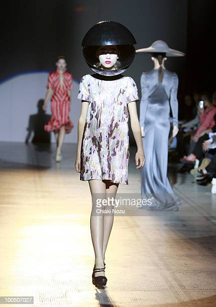 A model walks the runway at the Giles Deacon fashion show at the Victoria Albert Museum on July 17 2009 in London England