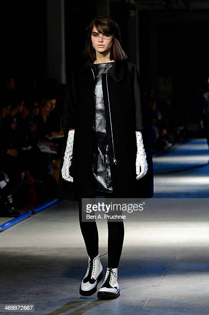 A model walks the runway at the Giles show at London Fashion Week AW14 at on February 17 2014 in London England