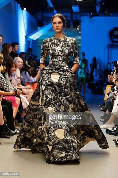 A model walks the runway at the GILES show during London Fashion Week Spring Summer 2015 on September 15 2014 in London England