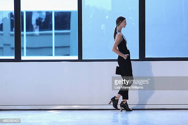 A model walks the runway at the Ginger Smart show at MercedesBenz Fashion Week Australia 2014 at Level 1 55 Mentmore Ave Rosebery on April 8 2014 in...