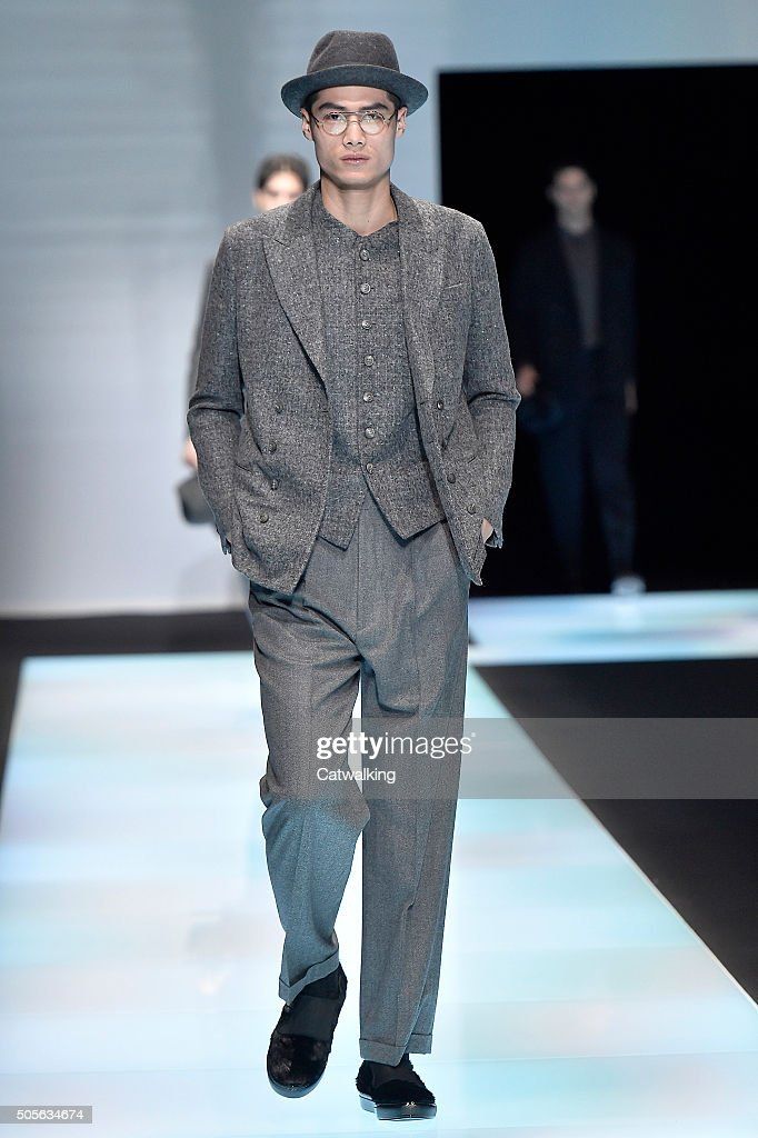 ceb3114e A model walks the runway at the Giorgio Armani Autumn Winter 2016 ...