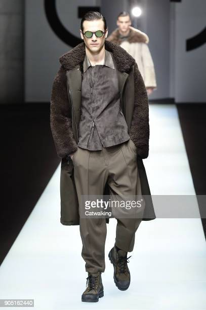 A model walks the runway at the Giorgio Armani Autumn Winter 2018 fashion show during Milan Menswear Fashion Week on January 15 2018 in Milan Italy