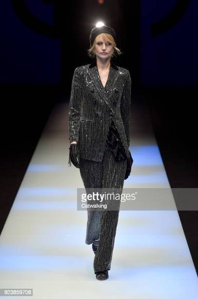 A model walks the runway at the Giorgio Armani Autumn Winter 2018 fashion show during Milan Fashion Week on February 24 2018 in Milan Italy
