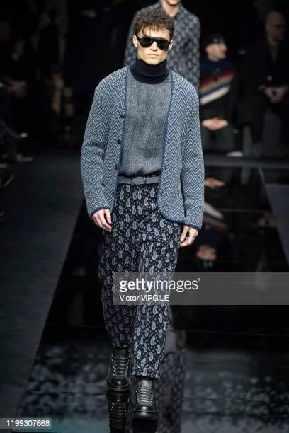 Model walks the runway at the Giorgio Armani Fall/Winter 2020-2021 fashion show during Milan Men's Fahion Week on January 13, 2020 in Milan, Italy.