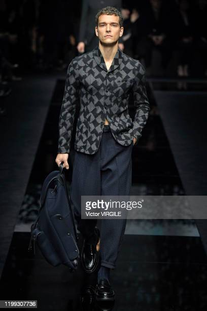 A model walks the runway at the Giorgio Armani Fall/Winter 20202021 fashion show during Milan Men's Fahion Week on January 13 2020 in Milan Italy