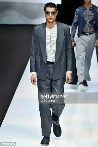 A model walks the runway at the Giorgio Armani fashion show during Milan Men's Fashion Week Spring/Summer 2019 on June 18 2018 in Milan Italy