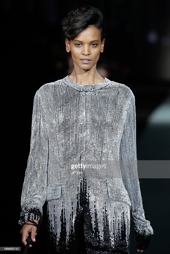 A model walks the runway at the Giorgio Armani One Night Only NYC at Hudson's River Park SuperPier on October 24, 2013 in New York City. Armani presented his most recent Prive collection, Nude, as well as a retrospective of his couture designs alongside his 'Eccentrico' exhibition.