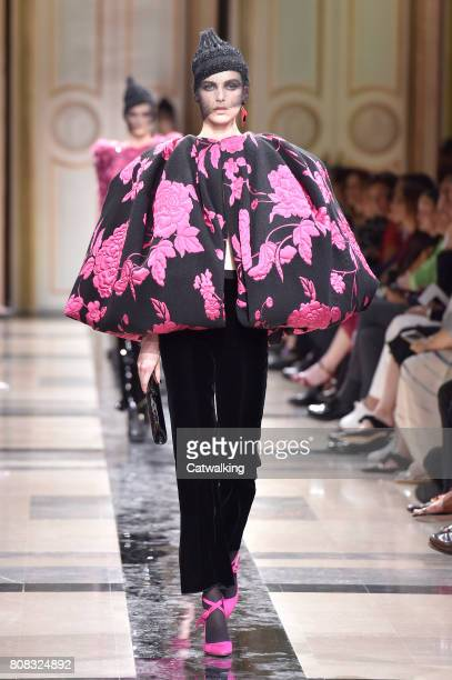 A model walks the runway at the Giorgio Armani Prive Autumn Winter 2017 fashion show during Paris Haute Couture Fashion Week on July 4 2017 in Paris...