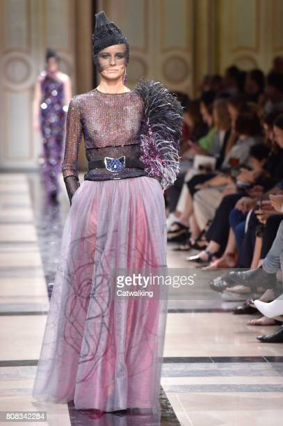 Model walks the runway at the Giorgio Armani Prive Autumn Winter 2017 fashion show during Paris Haute Couture Fashion Week on July 4, 2017 in Paris,...