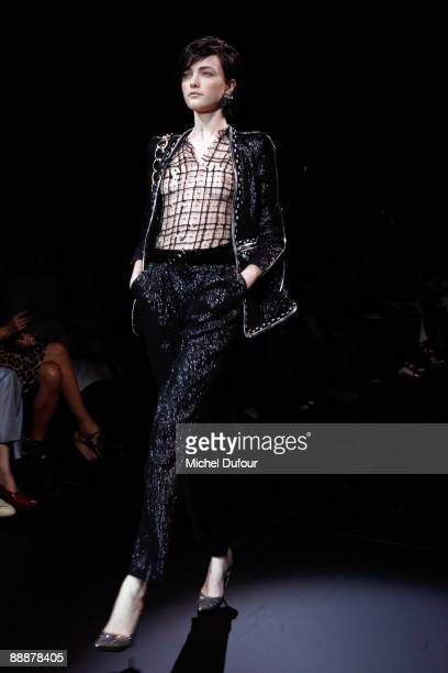 Model walks the runway at the Giorgio Armani Prive Haute Couture A/W 2010 fashion show during Paris fashion week at Palais de Chaillot on July 7,...