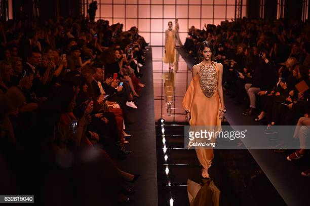 A model walks the runway at the Giorgio Armani Prive Spring Summer 2017 fashion show during Paris Haute Couture Fashion Week on January 24 2017 in...