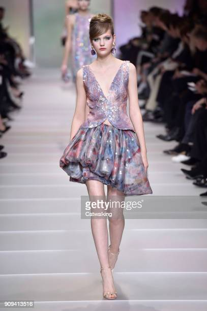 A model walks the runway at the Giorgio Armani Prive Spring Summer 2018 fashion show during Paris Haute Couture Fashion Week on January 23 2018 in...