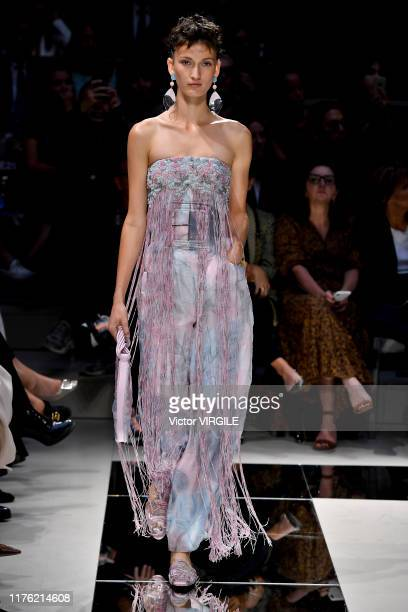 Model walks the runway at the Giorgio Armani Ready to Wear fashion show during the Milan Fashion Week Spring/Summer 2020 on September 21, 2019 in...