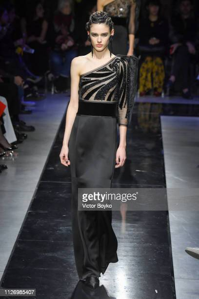 A model walks the runway at the Giorgio Armani show at Milan Fashion Week Autumn/Winter 2019/20 on February 23 2019 in Milan Italy