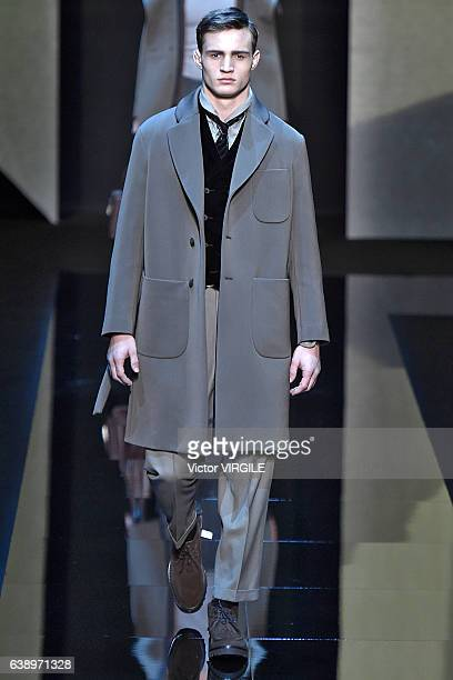A model walks the runway at the Giorgio Armani show during M Milan Men's Fashion Week Fall/Winter 2017/18 on January 17 2017 in Milan Italy
